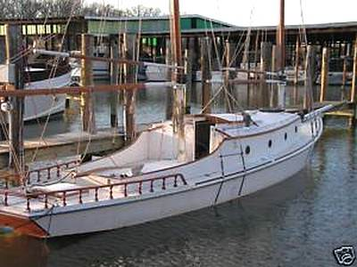 purchased a 1949 wooden Sharpie sailboat 2 years ago that had been ...
