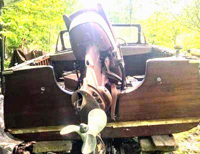 1958 Thompson Lapstrake Sea Coaster with the original 1958 Johnson Seahorse 35 hp engine, and original 1958 Mastercraft trailer.