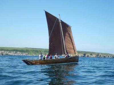 Obair-Na-Ghaol, which is one of the vessels built by Festival volunteers
