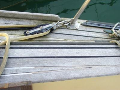 have a boat with a teak deck on which so much material has worn away
